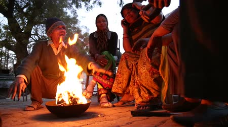 local : JODHPUR, INDIA - 12 FEBRUARY 2015: Local Indian people gathered around the fire at street in Jodhpur.