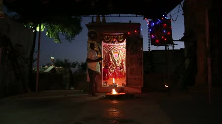 improvised : JODHPUR, INDIA - 14 FEBRUARY 2015: Indian man performing a religious ritual by improvised sanctuary. Stock Footage