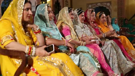 indian ethnicity : JODHPUR, INDIA - 15 FEBRUARY 2015: Women sitting in rows at traditional hindu wedding in Jodhpur.