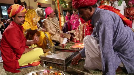 indian ethnicity : JODHPUR, INDIA - 15 FEBRUARY 2015: People preparing the hindu wedding ritual in Jodhpur.