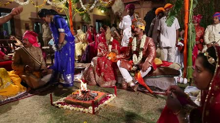 indian ethnicity : JODHPUR, INDIA - 15 FEBRUARY 2015: Indian couple getting married at a traditional hindu wedding in Jodhpur.
