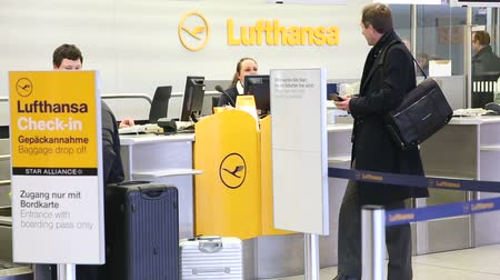 in : BERLIN, GERMANY - 28 JANUARY 2015: Man at check-in at Lufthansa counter at Tegel airport in Berlin, Germany. Stock Footage