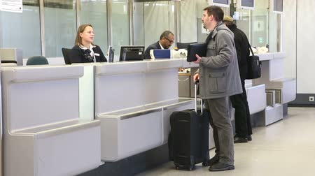 zkontrolovat : BERLIN, GERMANY - 28 JANUARY 2015: Man getting information at airport information desk at Tegel airport in Berlin.