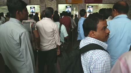 kuyruk : MUMBAI, INDIA - 8 JANUARY 2015: People waiting in a queue at the train station office in Mumbai. Stok Video