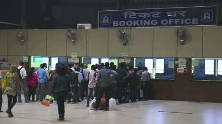 holiday makers : MUMBAI, INDIA - 8 JANUARY 2015: People waiting in queue at the booking office of a train station.