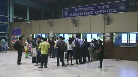 kuyruk : MUMBAI, INDIA - 8 JANUARY 2015: People waiting in queue at the booking office of a train station.