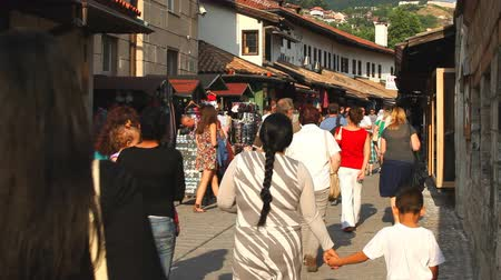 bascarsija : SARAJEVO, BOSNIA - AUGUST 13: Busy streets in the old town on August 13, 2012 in Sarajevo, Bosnia. Baarija, the old town market sector was founded by the Ottomans in the 15th century.