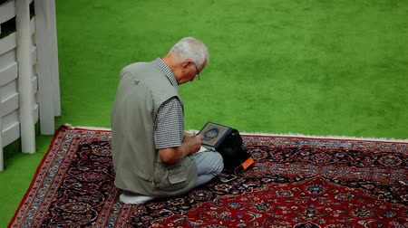 muslim leader : Zagreb, Croatia - September 25, 2012. Muslim devotee in afternoon prayer in mosque on September 25, 2012 in Zagreb, Croatia. Zagreb Dzamija is one of Europes largest mosque.