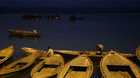 varanasi : Sailors on boats in bay of Ganges river in night time. Stock Footage