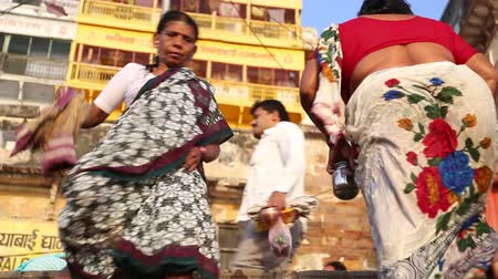 picturesque quarters : VARANASI, INDIA - 22 FEBRUARY 2015: Low angle view of people walking up and down the street stairs in Varanasi. Stock Footage