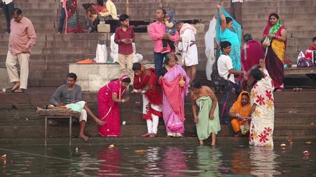 wanna : VARANASI, INDIA - 26 FEBRUARY 2015: Women and men at Ganges river ghat in Varanasi.