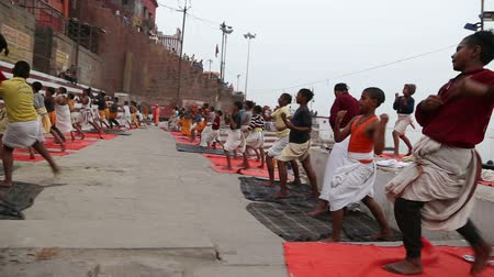 hint : VARANASI, INDIA - 19 FEBRUARY 2015: Indian boys practicing martial arts at dock of Ganges in Varanasi.