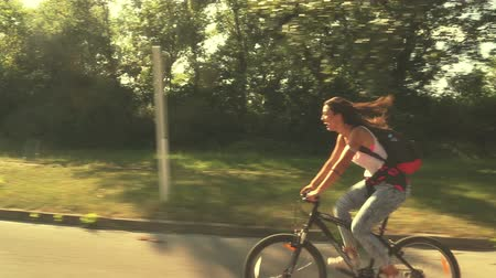 bisiklete binme : Beautiful young woman laughing and enjoying cycling, graded Stok Video