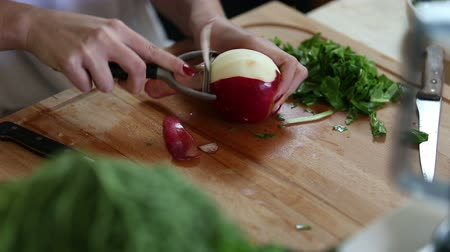 peeler : Close-up of woman hands peeling apple with peeler