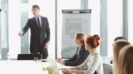 corporate : Business people talking during corporate presentation in conference room