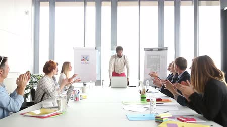 motive etmek : Happy business people clapping after presentation of their colleague in conference room Stok Video