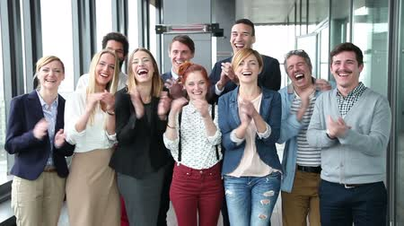 při pohledu na fotoaparát : Portrait of happy business and advertising team, laughing and clapping