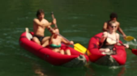 quatro : Close up of group of four young adults having fun riding canoe on beautiful Mreznica river, in slow motion