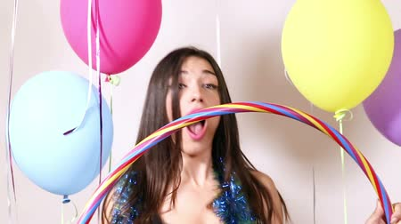abroncs : Close up of attractive brunette woman playing with hula hoop in party photo booth, graded Stock mozgókép