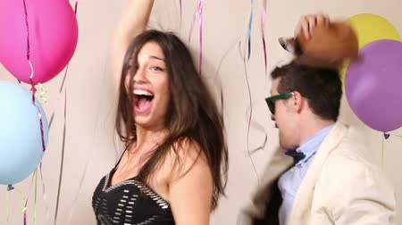 amalucado : Funny crazy couple having a great time dancing in party photo booth