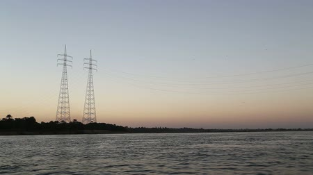 aswan : Electric pylons on the Nile at sunset, Egypt