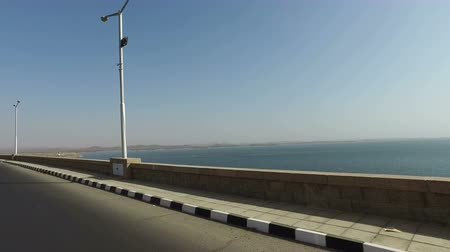 nasser : Driving across bridge to Aswan High Dam, Egypt Stock Footage