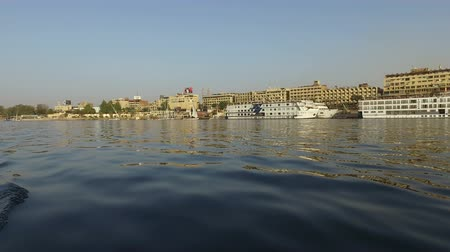 aswan : Boats on the Nile river at sunset near Aswan, Egypt Stock Footage