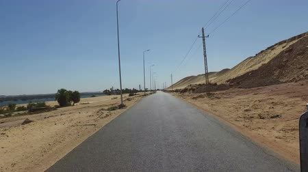aswan : View of desert road in Aswan, Egypt.