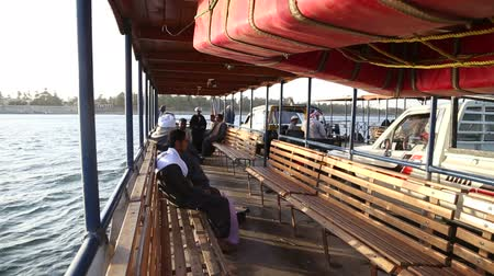 aswan : DARAW, EGYPT - 06 FEBRUARY 2016: Local man on ferry boat