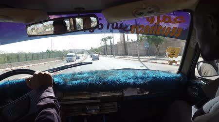 aswan : ASWAN, EGYPT - FEBRUARY 6, 2016: Woman driving in a taxi with local taxi driver and tourist guide