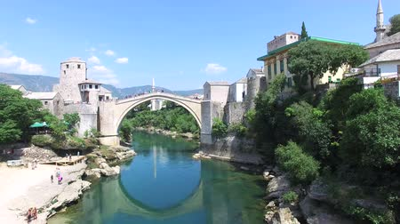 herzegovina : Flying away from famous bridge over river in Mostar, Bosnia and Herzegovina Stock Footage