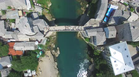 bosnia and herzegovina : Aerial view of bathing spot next to the famous bridge on Neretva river in Bosnia Stock Footage