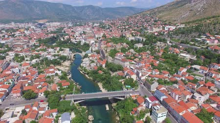 herzegovina : Aerial view of bridges and houses in Mostar, Bosnia and Herzegovina Stock Footage