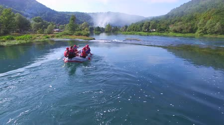bosnia and herzegovina : UNA, BOSNIA - JUNE 2014: Aerial view of rafters approaching rapids on Una river in Bosnia