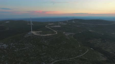 dozen : Aerial view of dozen windmills for the sustainable electricity production, at sunset Stock Footage