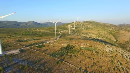 dozen : Aerial view of white windmills with rotating blades on a sunny day