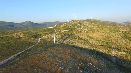 türbin : Aerial view of white windmills with rotating blades on a sunny day