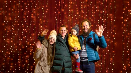 Family posing for photo at Christmas market.