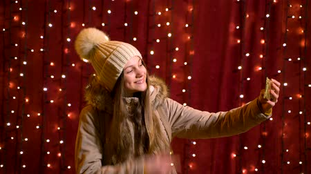 Beautiful teenager taking a selfie at Christmas market.