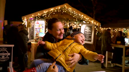 ZAGREB, CROATIA - 03 DECEMBER 2018: Mother and son enjoying at Christmas market in Zagreb, Croatia.