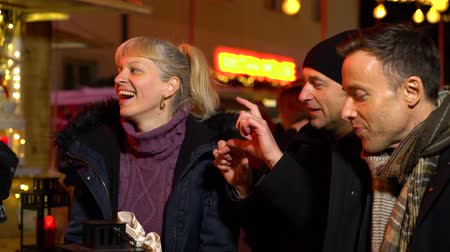 Couple laughing at Christmas market, Zagreb, Croatia.