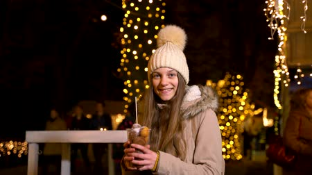 croatia : Cute teenager holding traditional food at Christmas market. Zagreb, Croatia Stock Footage