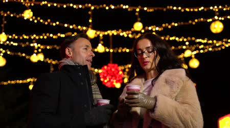 Couple talking at Christmas market. Zagreb, Croatia. Wideo