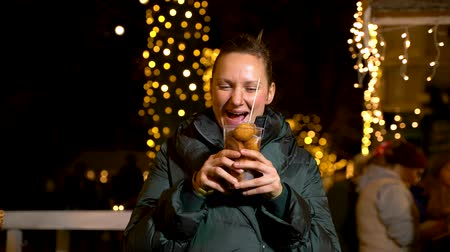 Woman holding traditional food at Christmas market. Zagreb, Croatia Wideo