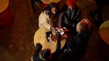 Above image of friends cheering with traditional drink at Christmas market, Zagreb, Croatia.