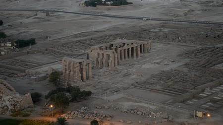 templom : Aerial view over the famous ancient temples on the west bank of Luxor in Egypt Stock mozgókép