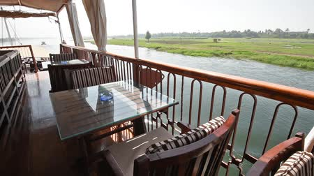 lanoví : View across large wide river Nile in Egypt to riverbank through rural countryside landscape from luxury sailing cruise boat