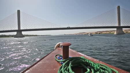palmo : Sailing towards large cable stayed road bridge spanning wide Nile river on a clear day in Egypt Vídeos