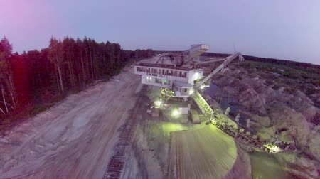 bagger : Huge sand mining excavator at night
