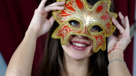 mask : Beautiful Woman in a Carnival Mask on Christmas tree background.